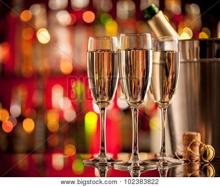 Glasses of champagne in holiday setting, served on bar counter