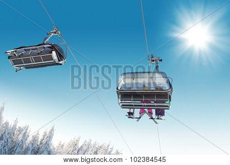 Skier sitting at ski lift in high mountains