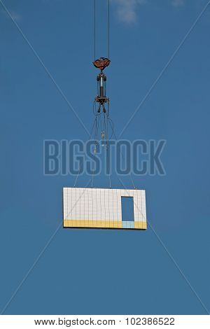 Concrete Plate On Crane Hook In The Air.