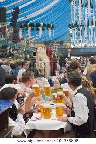 Table With Visitors At The Oktoberfest