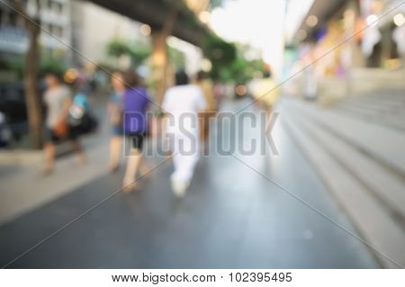 Blurry street with unrecognizable people