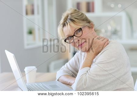 Portrait of senior woman working on laptop computer