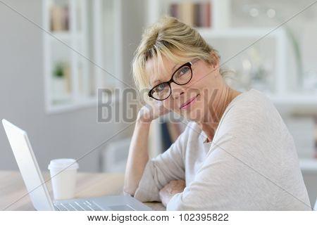 Portrait of senior woman working on laptop computer