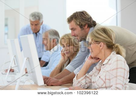 Group of senior people attending computing class