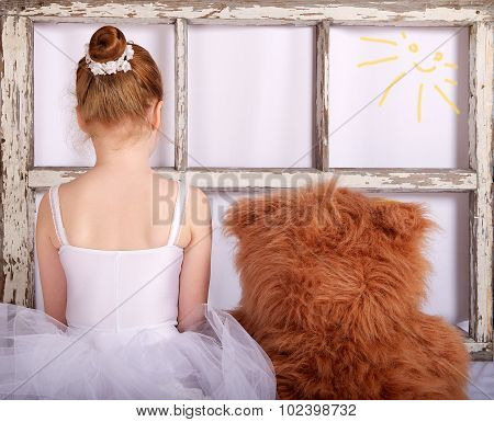 Unknown unrecognizable little girl with teddy bear, girl playing at home, artistic photo, little bal