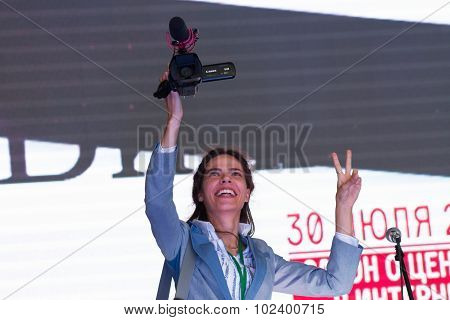 Unknown journalist with a video camera. A Russian opposition rally for democracy