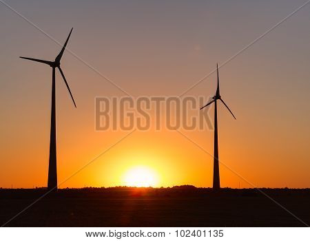 Wind power plant during sunset time. Lithuania