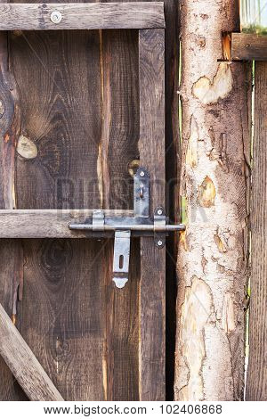 Old Lock On The Old Wooden Door With Wooden Texture, Selective Focus On The Lock