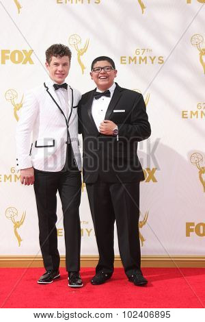 LOS ANGELES - SEP 20:  Nolan Gould, Rico Rodriguez at the Primetime Emmy Awards Arrivals at the Microsoft Theater on September 20, 2015 in Los Angeles, CA