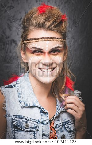 American Indian with paint face camouflage - studio photo with professional makeup