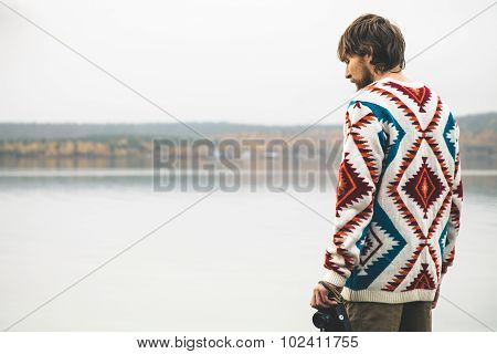 Young Man bearded with retro photo camera