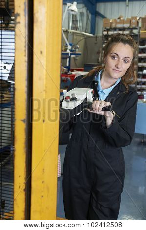Female Factory Worker Using Powered Fork Lift To Load Goods