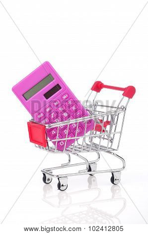 Calculator and Shopping Trolley On White Background