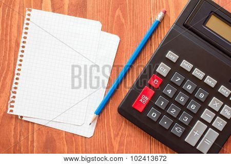 Paper Sheets And Calculator