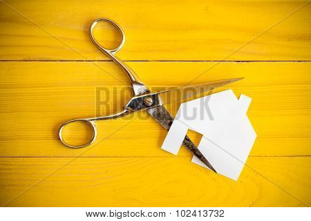 Scissors And House Cut Out Of Pape