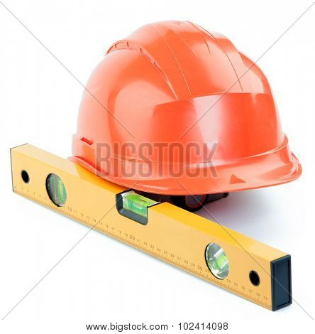 Level and the orange plastic construction Helmet on a white background
