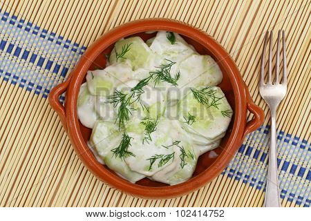 Cucumber salad with sour cream, dill and paprika
