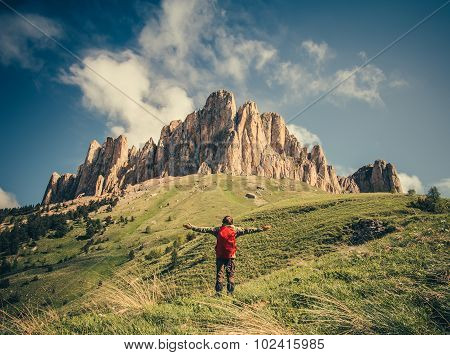Young Man with backpack raised hands relaxing outdoor