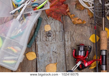 Fishing Tackles On Board With Leafs Of Autumn