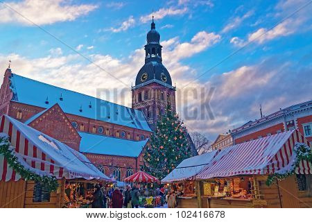 Christmas Market In Riga Filled With A Unique Atmosphere And Surrounded By Historical Scenery