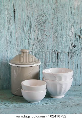 Vintage Cookware - Enameled Jar And White Ceramic  Bowl On A Blue Wooden Surface, Vintage And Rustic