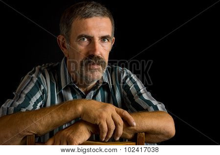 Portrait of Ukrainian peasant in low key
