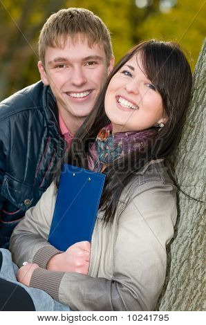 Portrait Of Cheerful Students Outdoors