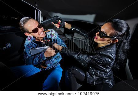 Two gangsters in the car