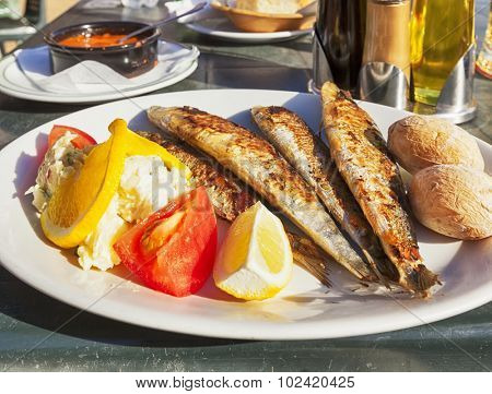 Grilled Sardines Dish on table of beach bar