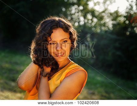 Woman Holds A Strand Of Her Hair