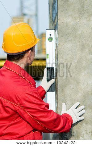 Builder With Digital Level