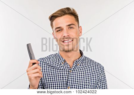 Handsome Young Man With A Comb