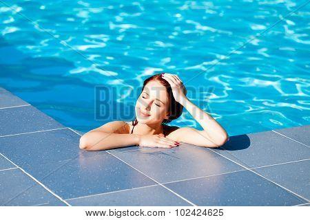Woman At Swimming Pool.