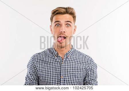 Cheerful Young Man Sticking His Tongue Out