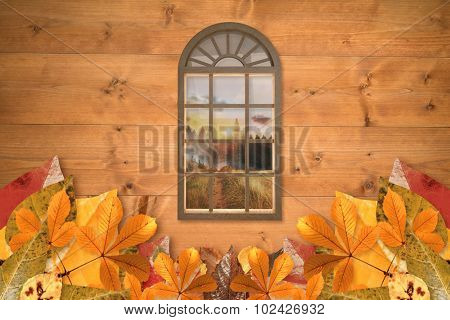 Digitally generated image of arch window against country scene