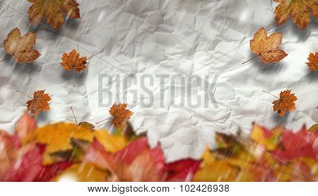 Autumn leaves against crumpled page
