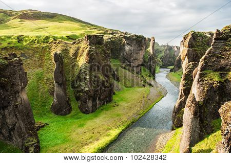 Beautiful Fjadrargljufur Canyon With River And Big Rocks