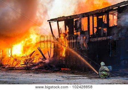 Fireman Extinguishes A Burning House