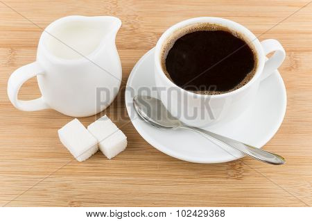 Hot Cup Of Coffee, Jug Milk, Spoon And Sugar