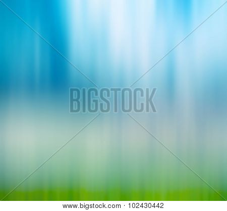Abstract blur background of blue sky and grass