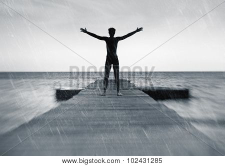 Freedom in nature concept - free happy man in the rain