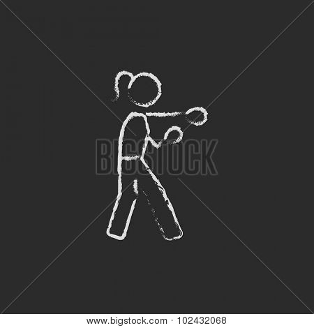 Female boxer hand drawn in chalk on a blackboard vector white icon isolated on a black background.