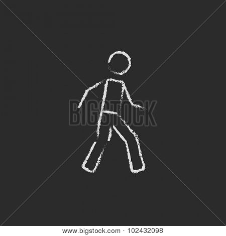 Pedestrian ism hand drawn in chalk on a blackboard vector white icon isolated on a black background.