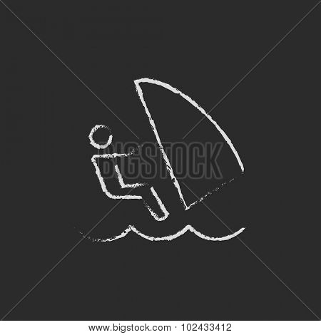 Wind surfing hand drawn in chalk on a blackboard vector white icon isolated on a black background.