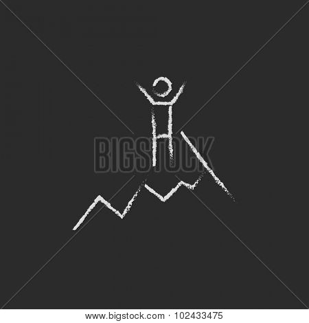 Climbing hand drawn in chalk on a blackboard vector white icon isolated on a black background.