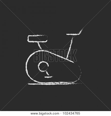 Exercise bike hand drawn in chalk on a blackboard vector white icon isolated on a black background.