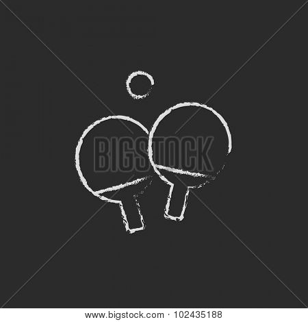 Table tennis racket and ball hand drawn in chalk on a blackboard vector white icon isolated on a black background.
