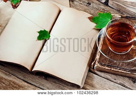 Open Book With Blank Pages And A Cup Of Tea