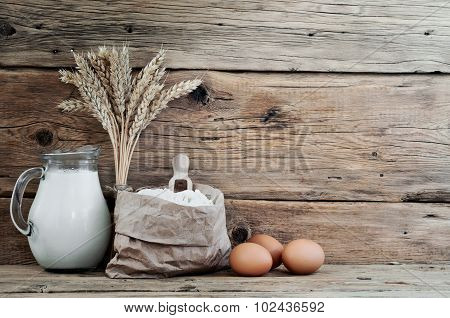 Bag Of Flour With Spikelets Of Wheat, Milk And Eggs