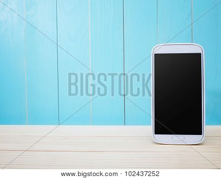 Smart Phone On Light Blue Wooden Background
